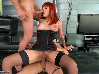 Entrancing redhead gets her tasty holes double penetrated by two huge-cocked dudes