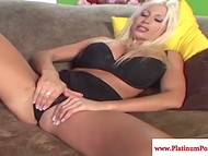 Blonde pornstar named Puma Swede slowly takes off black lingerie to show perfectness of her desired body