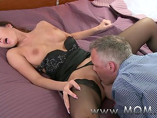 Lady dressed in elegant black stockings exchanging her vagina for cunnilingus given by her lover