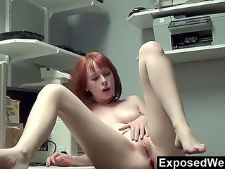 Wonderful red-haired fox stimulates her gentle pussy with careful fingers in the amateur video