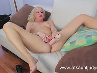 Ravishing MILF was armed with a long dildo satisfying her needs on the camera