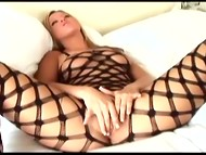 Solo blonde chick in roped bodystocking slowly masturbates her vagina with the help of the long fingers