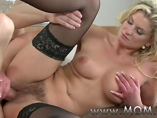 Seductive blonde MILF in stockings is happy that a youngster payed attention to her hairy vagina