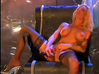 Adorable blonde in black stockings moving dildo fast inside her pussy