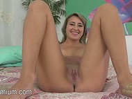 Astonishing Marina Angel is sitting on the bed and slowly rubbing her yummy clit   7