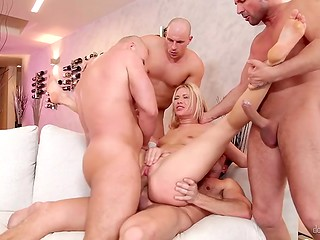 Some guys are drilling all holes of yummy blonde babe during the gang bang scene