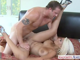 Big titted blonde pornstar Bridgette B attacks lucky dude with her sexuality