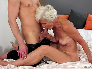 Young guy helped granny to remember the college years bouncing on the cock
