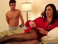 Gorgeous dame Kendra Lust puts on elegant lingerie and black stoking to prepare herself for admirer
