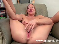 Experienced MILF Alyssa Dutch is sitting in the comfortable armchair and rubbing her V