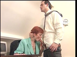 Mature copper-top secretary in nubile lingerie was fucked by the horny co-worker on her table