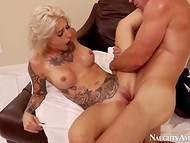 Tattooed woman with huge breasts was fucked from behind by famous Johnny Sins