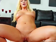 Blonde Addison Avery sat down on the penis after she has moistened it with her mouth
