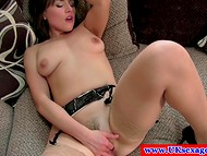 Dark-haired sweetie in black lingerie passionately masturbating during the interview