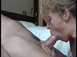Mature woman with her hands and mouth makes her husband explode
