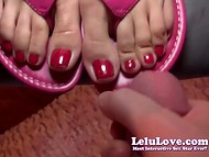 Pleasant female with red-nailed fingers gave a relaxing footjob to her chap 11