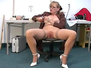 Mature slut in stockings showing her sex toys on camera