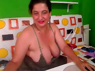 Mature BBW showing her enormous boobs on webcam