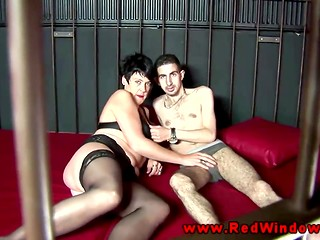 Experienced mature whore in stockings sucks foreigner's member on the camera