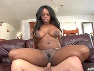 Black-skinned MILF gets a lot of pleasure having sex with a tender white man