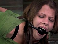 Beautiful brunette in green blouse and purple shoes screamed after every lash 8