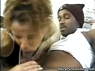 Hairy pussy got carefully prepared for further penetration with the huge dick of black guy