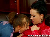 Three young lesbian chicks get really excited being caught in the golden rain 8