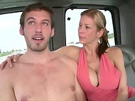 Youngster held back under the onslaught of busty mistress on the back seats