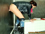 Long-legged brunette attached her skinny ass to the rubber penis sticking from the wall