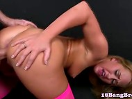 Sexy 18-year-old sweetie in pink stockings takes that hard schlong from behind