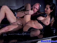 Fantastic pierced enchantress having fun with bald guy on the kitchen table