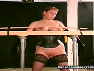 Dirty-minded MILF in stockings gets her huge breasts bondaged and her cooch fingered