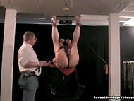 Harmless by appearance male suspended trustful girl to the ceiling and spanked her ass with a whip