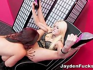 Red-haired coquette tits had fun with her slender blonde girlfriend on the soft armchair