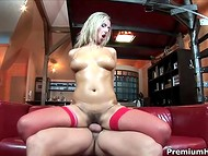 Red stockings look perfectly on the desired body of the busty blonde slut