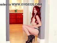 Frisky teenage beauty with fiery-red hair slowly takes off her lingerie and shows the charms