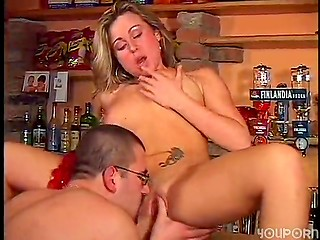 Randy lady rides strong cock in bar