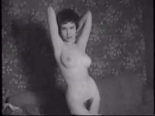 Vintage video with woman who takes off her clothes and shows her hairy pussy