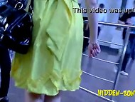 Fellow with camera is walking around the city and peeking under women skirts 6