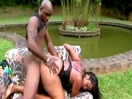 Chubby lady from Brazil was fucked by black-skinned chap on the lawn by the pond