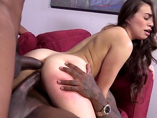 Pale-skinned body of Tiffany Doll fell under the pressure of two black huge cocks