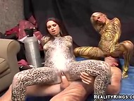 Two wild hotties with sexy bodyart have threesome sex with a horny buddy