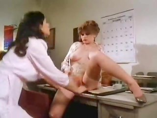 Hot vintage lesbians kissing and getting naughty in office