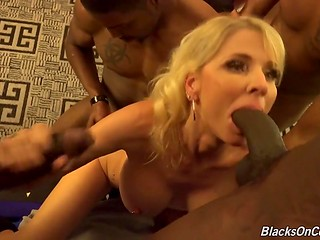 Blonde mature decided to prove that she is a goddess of porn and called a crowd of brutal black males