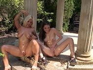 Lustful lesbians bought a dual-ended dildo and tasted it during the walk outdoors