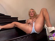 Blonde hottie gets completely naked and starts playing with a pink sex toy on the stairs 5
