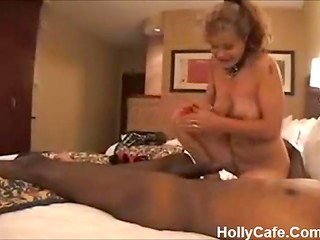 Mature woman loves to fondle black dick