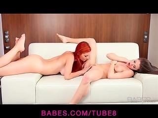 Redhead lesbian fondling her dark-haired girlfriend