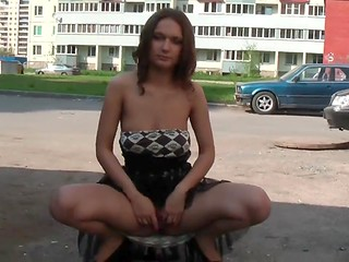 Russian slut demonstrates shaved genitals on the streets of her city