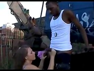 Chubby tranny and black fucker give each other a mouthjob behind the old excavator